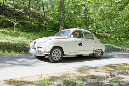 STOCKHOLM, SWEDEN - MAY 20, 2018: White color Saab Sport classic car from 1962 driving in the public race Gardesloppet in the forests at Djurgarden, Stockholm, Sweden. May 20, 2018