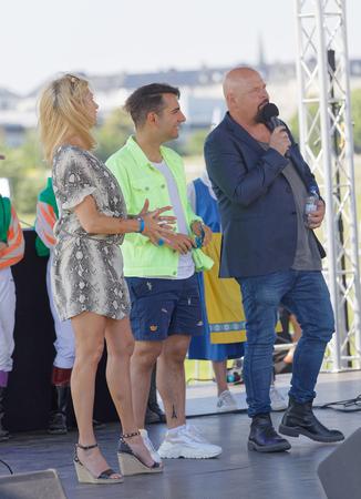 STOCKHOLM, SWEDEN - JUNE 06, 2019: Judges of the hat parade, Ann Wilson, Daniel Paris and Anders Bagge at Nationaldags Galoppen at Gardet. June 6, 2019 in Stockholm, Sweden