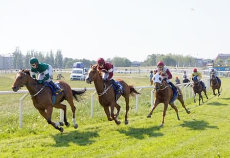 STOCKHOLM, SWEDEN - JUNE 06, 2019: Jockeys riding arabian race horses on the race track at ATG Nationaldags Galoppen at Gardet. June 6, 2019 in Stockholm, Sweden