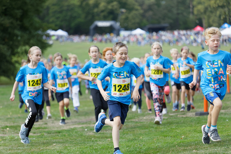 STOCKHOLM - SEPT 08, 2019: Happy kids running during the Generation PEP day in Hagaparken to encourage kids to physical activity, initiated by prins Daniel. Stockholm,Sweden,September 08, 2019