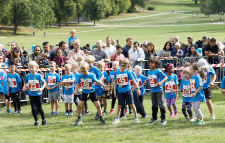 STOCKHOLM - SEPT 08, 2019: Children warming up before the Prins Daniel race during the Generation PEP day in Hagaparken, initiated to encourage to physical activity. Stockholm,Sweden,September 08, 2019 Editorial
