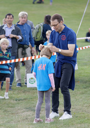 STOCKHOLM - SEPT 08, 2019: Proud kids getting their medals from Prins Daniel  after the Prins Daniel race. Stockholm,Sweden,September 08, 2019