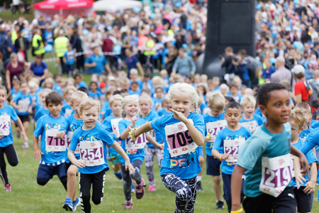 STOCKHOLM - SEPT 08, 2019: Kids running during the Generation PEP day in Hagaparken to encourage kids to physical activity, initiated by prins Daniel. Stockholm,Sweden,September 08, 2019