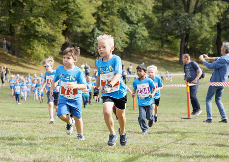 STOCKHOLM - SEPT 08, 2019: Kids running in the nature during the Generation PEP day in Hagaparken, to make kids be more physical active and more healthy, initiated by the swedish prins Daniel and princess Victoria. Stockholm,Sweden,September 08, 2019