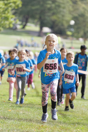 STOCKHOLM - SEPT 08, 2019: Kids running during the Generation PEP day in Hagaparken, to make kids be more physical active and more healthy, initiated by the swedish prins Daniel and princess Victoria. Stockholm,Sweden,September 08, 2019