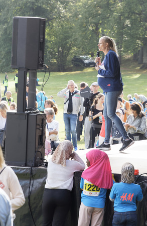 STOCKHOLM - SEPT 08, 2019: The Heptathlon athlete and operations manager for the Generation PEP organisation Carolina Kluft talking in a microphone. Stockholm,Sweden,September 08, 2019 Editorial