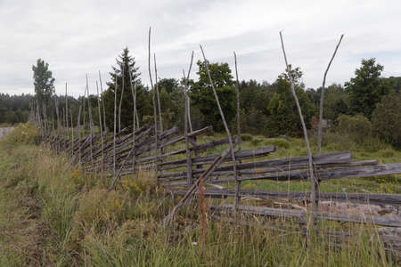Rural fence made of wood to prevent the cattle to run away during summer Standard-Bild