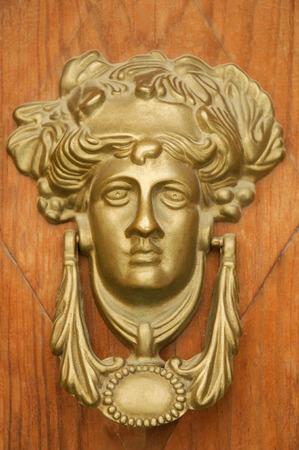 knocking: Greek Goddess knocking on the wooden door.