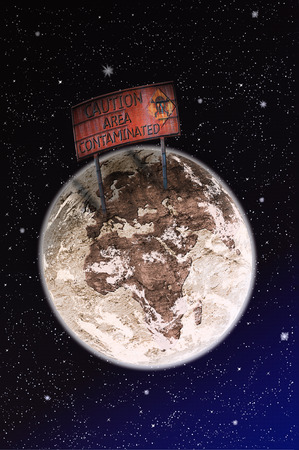 big warning sign warns on planet Earth is contaminated. Stock Photo