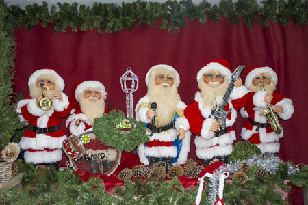 santa claus toys celebrate christmas playing various music instruments and singing stock photo 92140949 - Singing Christmas Toys
