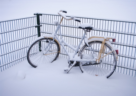 bury: abandoned bicycle covered with snow