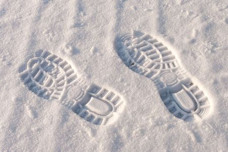 left and right footprint in snow photo