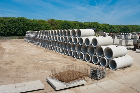 cement pile: concrete pipes on a large storage area. They are used for culverts Stock Photo