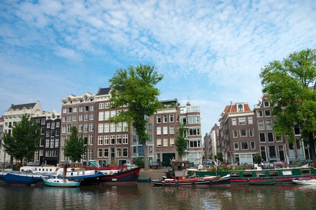 medieval amsterdam houses with their typically facades along a canal photo