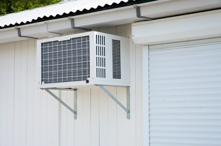 mobile office: airconditioner on the outside of a mobile office unit Stock Photo