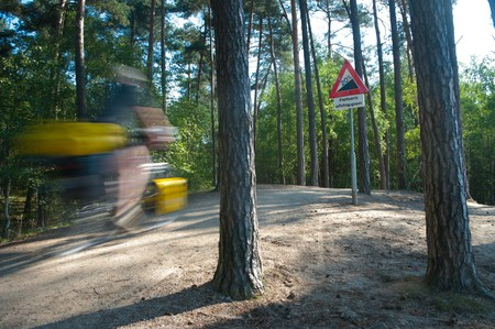 despite: biker trying to take the 20 percent hill, despite the warning to get off his bike.