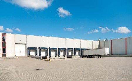 warehouse with docks for loading and unloading trucks Stock Photo