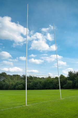 rugby post against cloudy blue sky Stock Photo