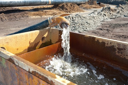 pumping away groundwater in a basin
