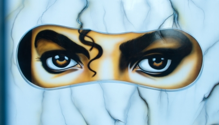 larger: mask with the eyes of michael jackson showing. It,s part of a larger statue of the artist.