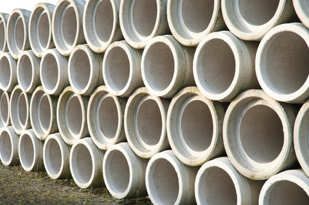 cement pile: concrete drainage pipes stacked on a construction site Stock Photo
