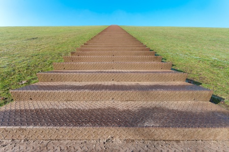 huge stairway leading to the top of a green hill photo