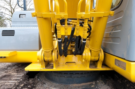 close-up of the hydraulic part of an excavator photo