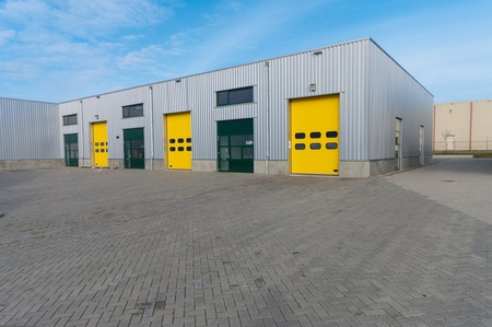 industrial warehouse with green and yellow roller doors