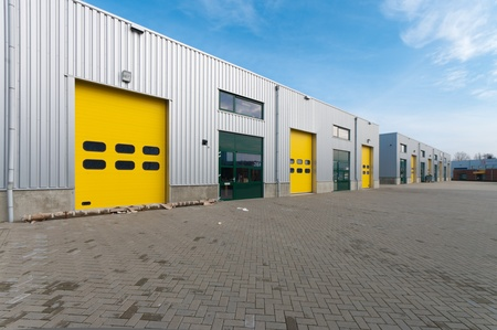 industrial warehouse with green and yellow roller doors Stock Photo - 8903899