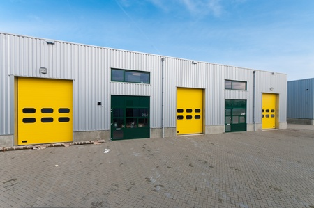industrial warehouse with green and yellow roller doors Stock Photo - 8903898