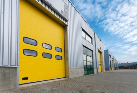 industrial warehouse with green and yellow roller doors photo