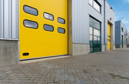 industrial warehouse with green and yellow roller doors Stock Photo - 8903900