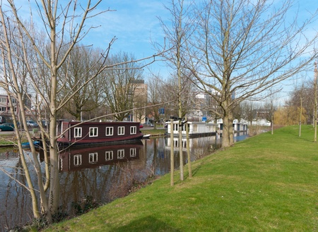 houseboats in a canal in Leiden, Netherlands photo