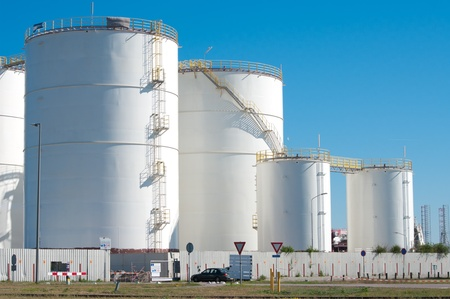 gas tank: large white tanks for petrol and oil in the Rotterdam harbor Stock Photo