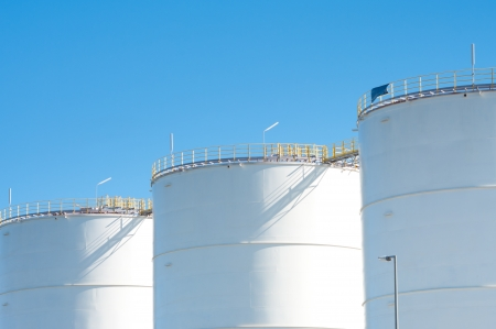 silo: large white tanks for petrol and oil in the Rotterdam harbor Stock Photo