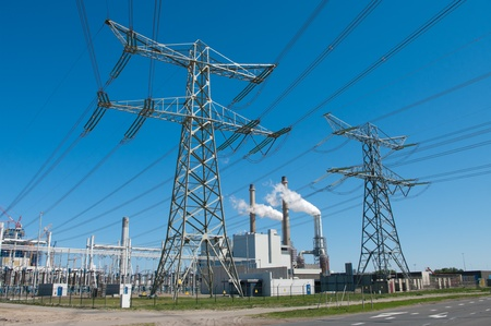 electricity pylons and power plant in rotterdam, netherlands