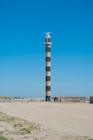 illuminative: simple lighthouse at the maasvlakte in Rotterdam