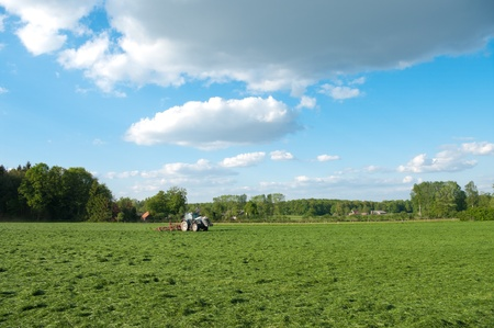 farmer busy with tractor to flip just mowed grass Stock Photo - 9772626