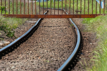 iron barred: fence over a railroad to prevent entering an industrial area