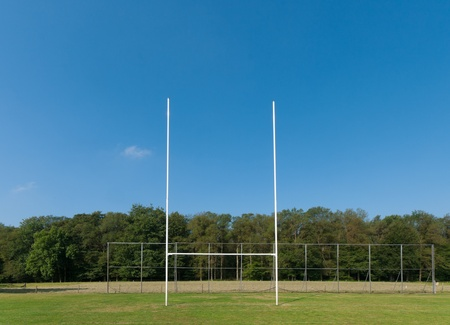 rugby team: rugby field with rugby post in front Stock Photo