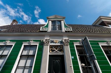 facade of a beautiful wooden house against a blue sky in Zaanse Schans, netherlands Stock Photo - 10086015