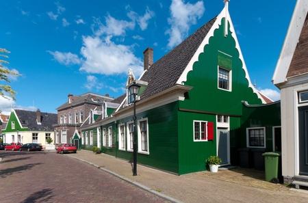 zaan: beautiful green wooden houses against in Zaanse Schans, netherlands