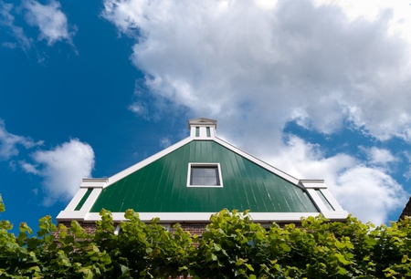 facade of a beautiful wooden house against a blue sky in Zaanse Schans, netherlands Stock Photo - 10088538