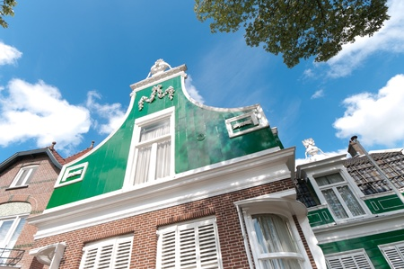 facade of a beautiful wooden house against a blue sky in Zaanse Schans, netherlands Stock Photo - 10086013