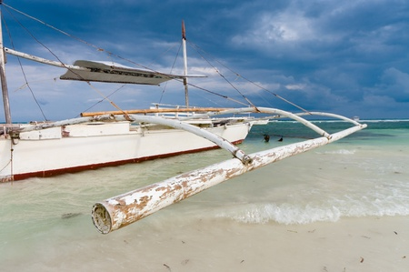 philippine: traditional philippine bangka at low tide