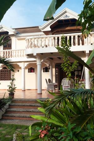 entrance of tropical villa in a beautiful garden