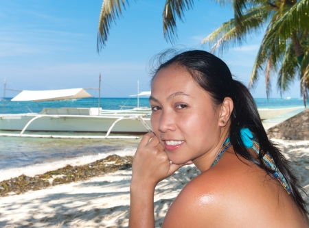 philippine woman on a beach photo