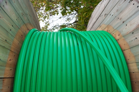 fibre optic: cable drum with green fiber glass cable