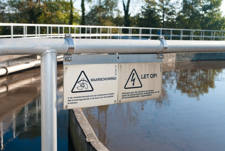 shield on a waste water plant warning for the rotating propeller in the bassin Stock Photo - 11305925