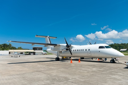 small commercial airplane parked at boracay airport, Philippines